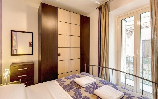 Wonderful Bedroom with Wardrobe and Bright Window| Accomodation in Luxury Apartments, Rome, Italy