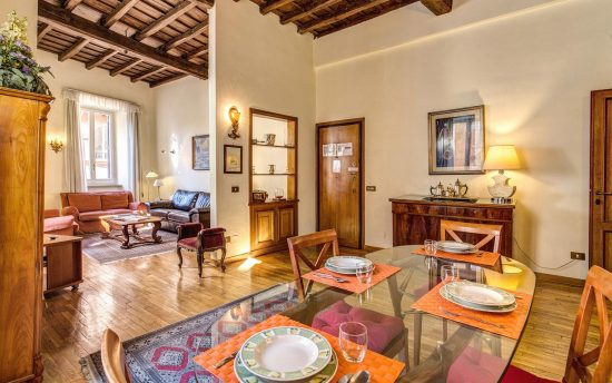 Apartment in rome center. Lunchroom with Crystal Table and Ceiling with Wooden Beams | Apartments in the Center of Rome, Italy