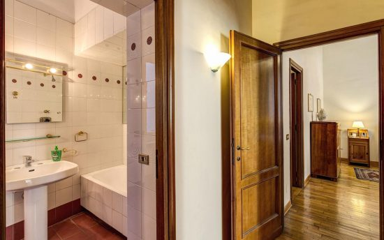 Apartment in rome center. Double View of the Bathroom and Hallaway | Apartments in the Center of Rome, Italy