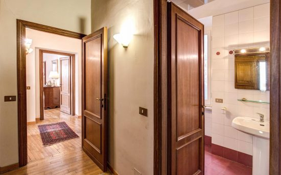Apartment in rome center. Wooden Doors in Bathroom and Hallaway Double View | Apartments in the Center of Rome, Italy