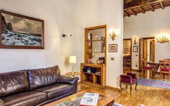 Apartment in rome center. Living Room with a Double Sofa and a dining area | Rome Apartments for Rent